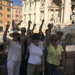"A ""pretend"" toss of those coins in the Trevi Fountain."