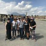 Visiting Pompeii with guide Paola.  That is Mount Vesuvius in the background.