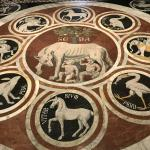One of the many marble floor mosaics inside the Duomo.